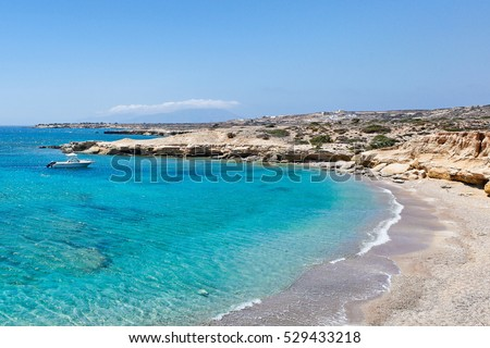 Michaliou Kipos beach with eaten by the sea cliffs and unique caves in Karpathos, Greece