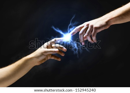 Michelangelo God's touch. Close up of human hands touching with fingers - stock photo