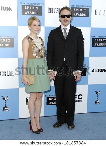 Michelle Williams, in a Chloe dress, Heath Ledger, in Ray-Ban sunglasses, attending Film Independent Spirit Awards, Santa Monica Beach, Los Angeles, February 24, 2007 - stock photo