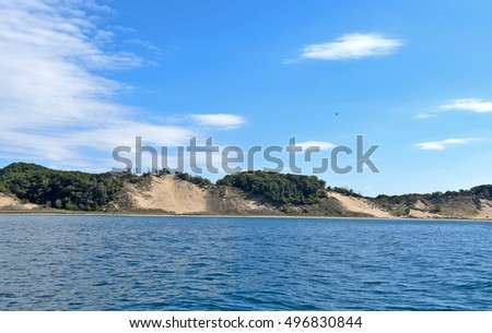 Michigan coastline with sand dunes and trees