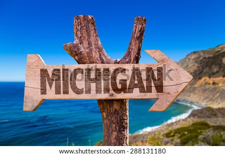 Michigan wooden sign with coastal background - stock photo