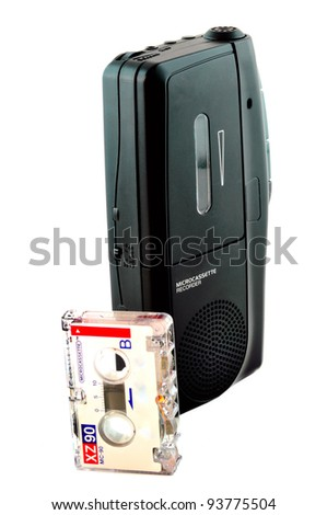 Micro cassette recorder and a cassette with the film photographed against a white background - stock photo