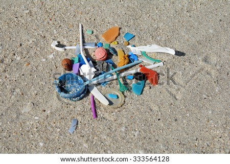 Micro plastic fragments in the sand of a beach