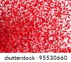 Micro red particles in liquid. high magnification macro. - stock photo