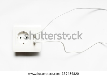 Micro-usb wire, connected to the socket with two usb-charging ports.