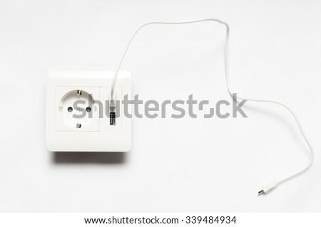 Micro-usb wire, connected to the socket with two usb-charging ports. - stock photo