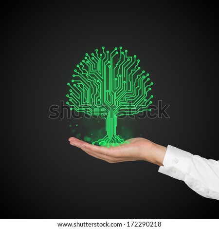 Microchip green tree and a hand - stock photo