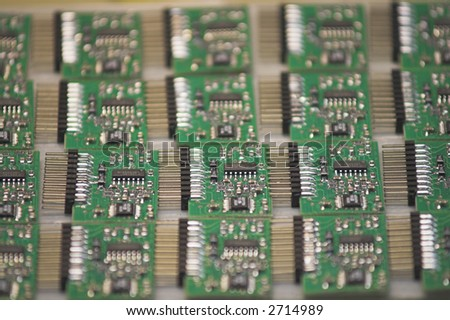 Microchips - A stack of microchips lying on a table. - stock photo