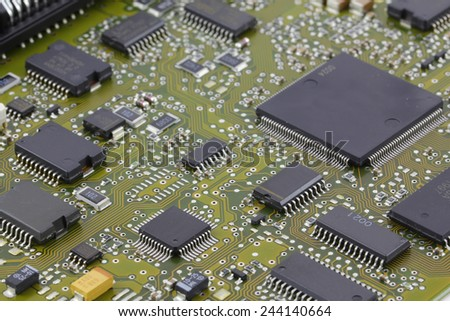 Microchips in a motherboard, electronic components - stock photo