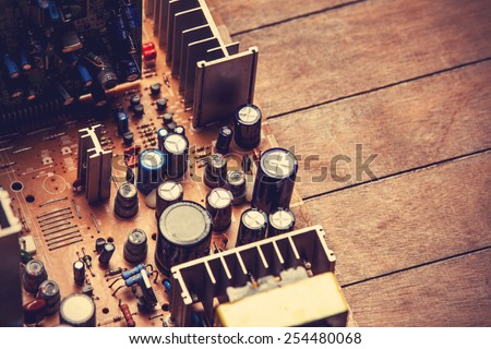 Microchips in old circuit board printed circuit board. - stock photo