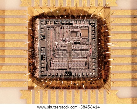 Microcircuit crystal the size 4x4mm, close up at substantial magnification - stock photo