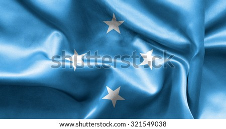 Micronesia flag texture creased and crumpled up with light and shadows