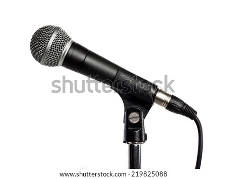 Microphone against white background - stock photo