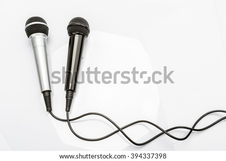 Microphone and cable isolated on white background - stock photo