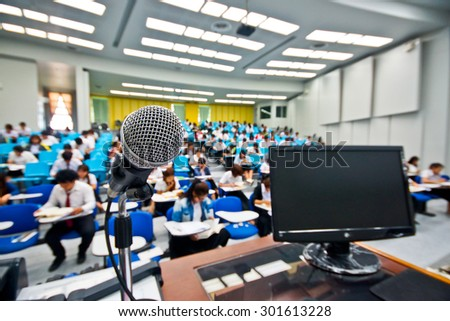 microphone and computer in a classroom - stock photo