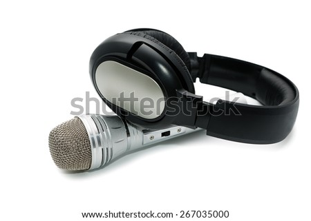 Microphone and ear-phones on a white background - stock photo