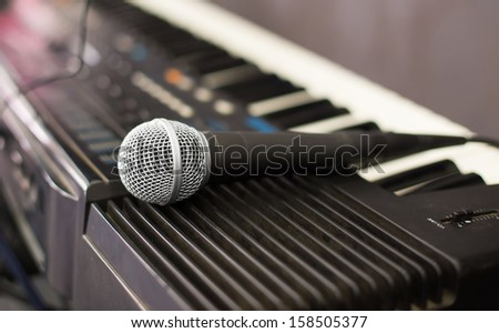 Microphone and electronic keyboard. Are isolated on a white background.