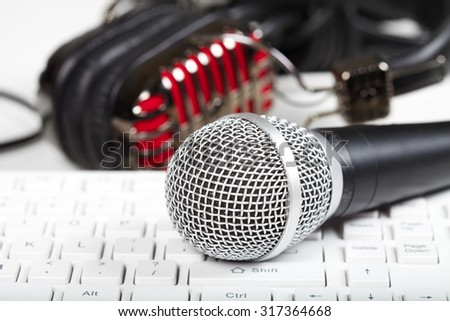Microphone and headphones on the keyboard. Music and singing