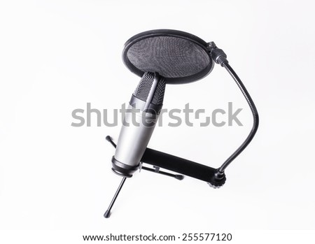 Microphone and pop filter in sound studio isolated on white background - stock photo