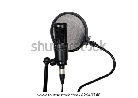 Microphone and pop filter in sound studio on white background - stock photo