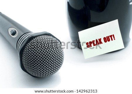 microphone and speak out notice stuck on drinking mug