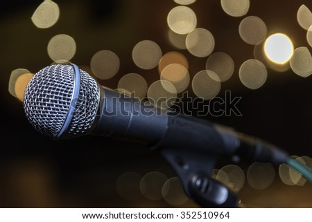 Microphone at the concert hall with beautiful bokeh of light