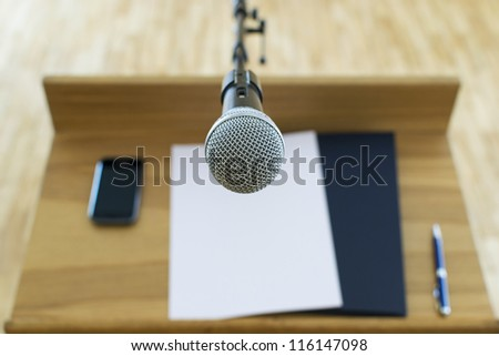 Microphone at the speech podium - stock photo