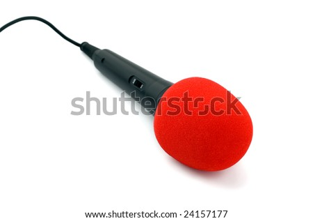 Microphone black in red close-up isolated on white background - stock photo