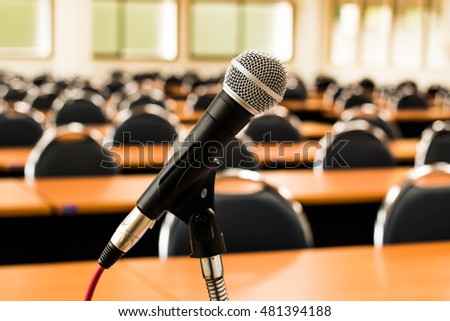 Microphone blur concept in class room.