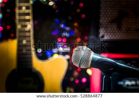 microphone, blur guitar background.
