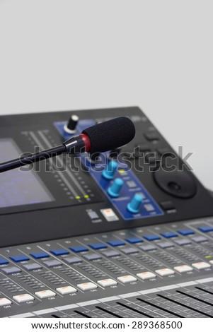 Microphone close background audio mixer. - stock photo