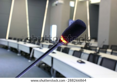 Microphone closeup in meetting room - stock photo