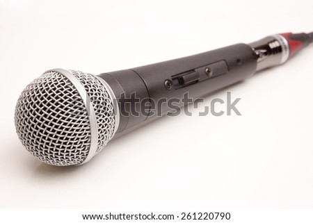 Microphone connected wire isolated on white background - stock photo
