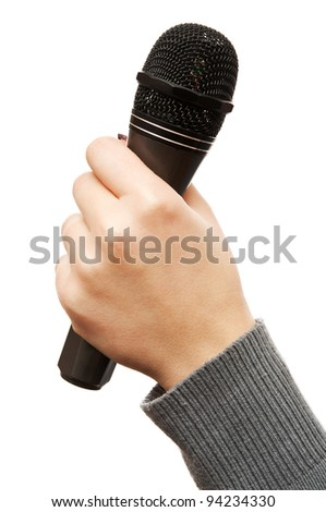 microphone for karaoke in hand isolated on a white background - stock photo
