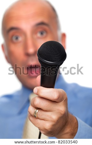 Microphone held by a surprised reporter - stock photo