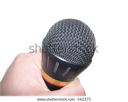 microphone held over a light background - stock photo