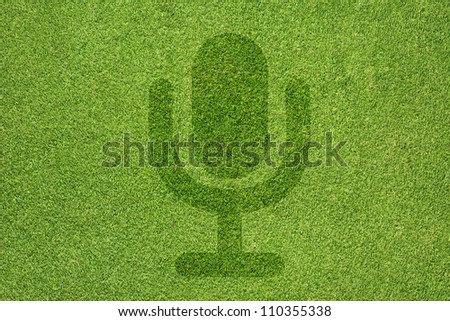 Microphone icon on green grass texture and  background