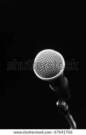 Microphone in a Black background - stock photo
