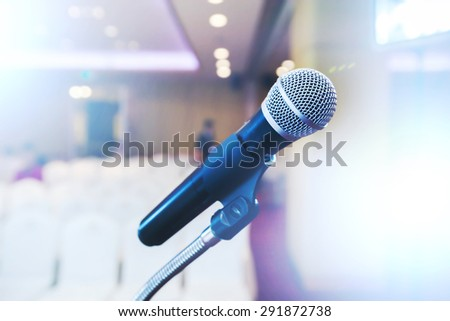 microphone in a conference room with extremely shallow dof - stock photo