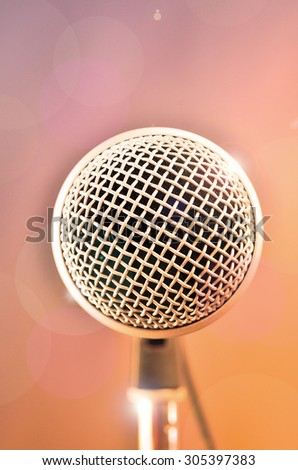 Microphone in a studio with bright light and glamour effects