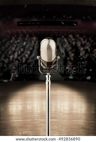 microphone in concert hall or conference room and the audience