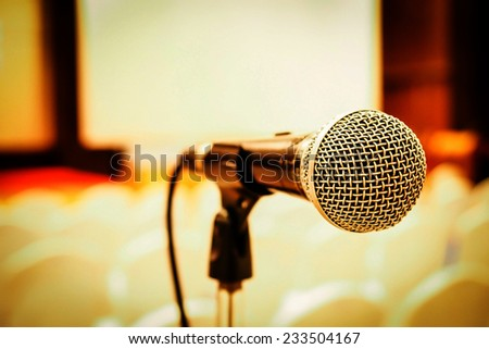 Microphone in concert hall or conference room . Right side