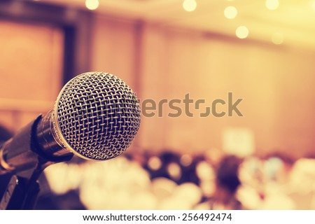Microphone in concert hall or conference room with defocused bokeh lights in background. Extremely shallow dof.  : Vintage style and  filtered process - stock photo