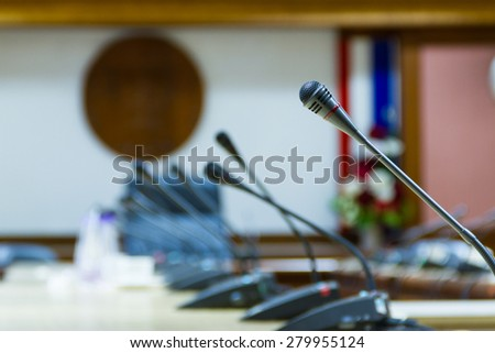 Microphone in conference room - stock photo