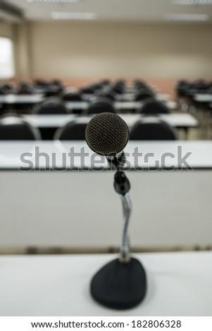 Microphone in empty classroom - stock photo