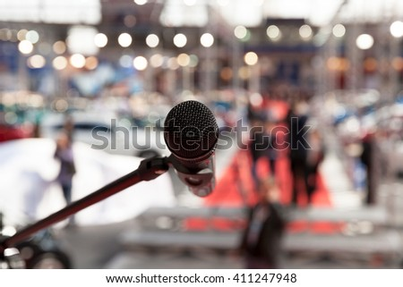 Microphone in focus against blurred background - stock photo