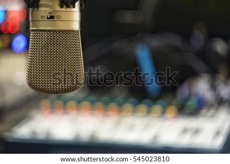 Microphone in onair room with mixer and headphone