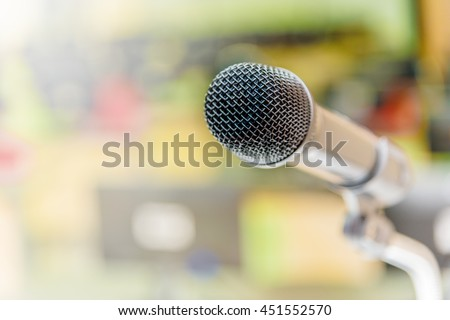 Microphone in the computer room for talker with defocused background, selective focus on microphone  - stock photo
