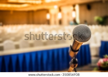 Microphone in the conference room for talker, the art or practice of formal speaking in public with defocused background, selective focus on microphone  - stock photo