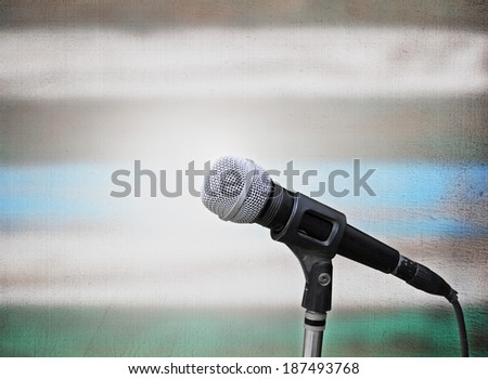 Microphone isolated on stage background